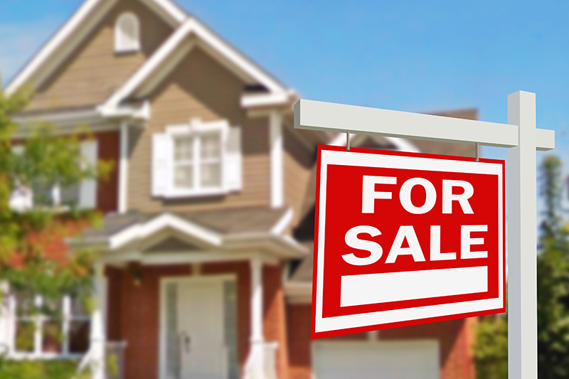 For sale sign in front of a house before receiving thorough home inspection services