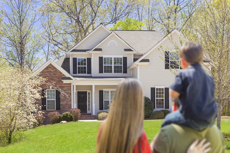 Family looking at new home with Home Inspector Doug